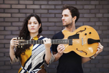 Portrait of Yumi Ito and Szymon Mika handled a guitar